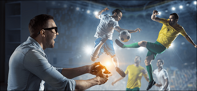 A man playing a realistic soccer video game