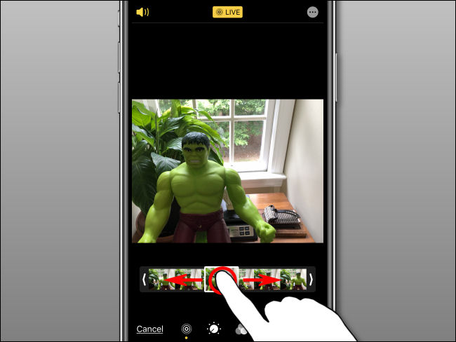 Use your finger to select a key photo on the filmstrip in Photos on iPhone.
